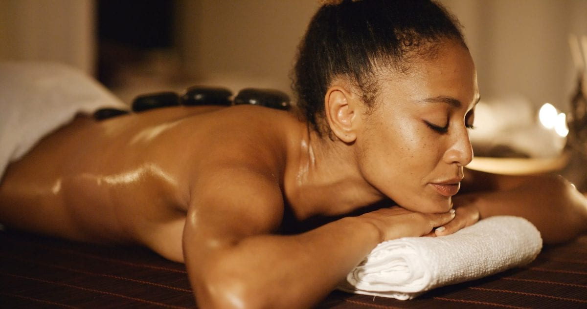 Black woman relaxing in spa