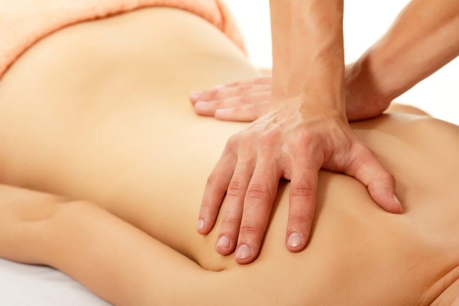 Man massaging woman's back